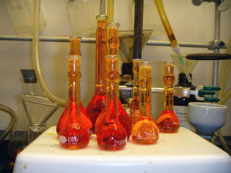 Aqua regia solutions have a reddish-orange color. The solution is hazardous to work with and should be used immediately after preparation or else it loses potency.