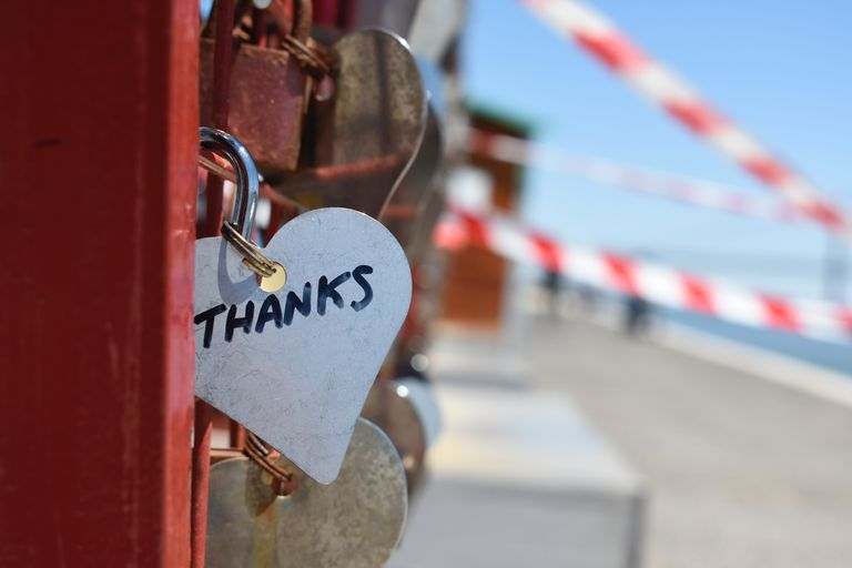 "Heart-shaped lock bearing the word ""thanks."""