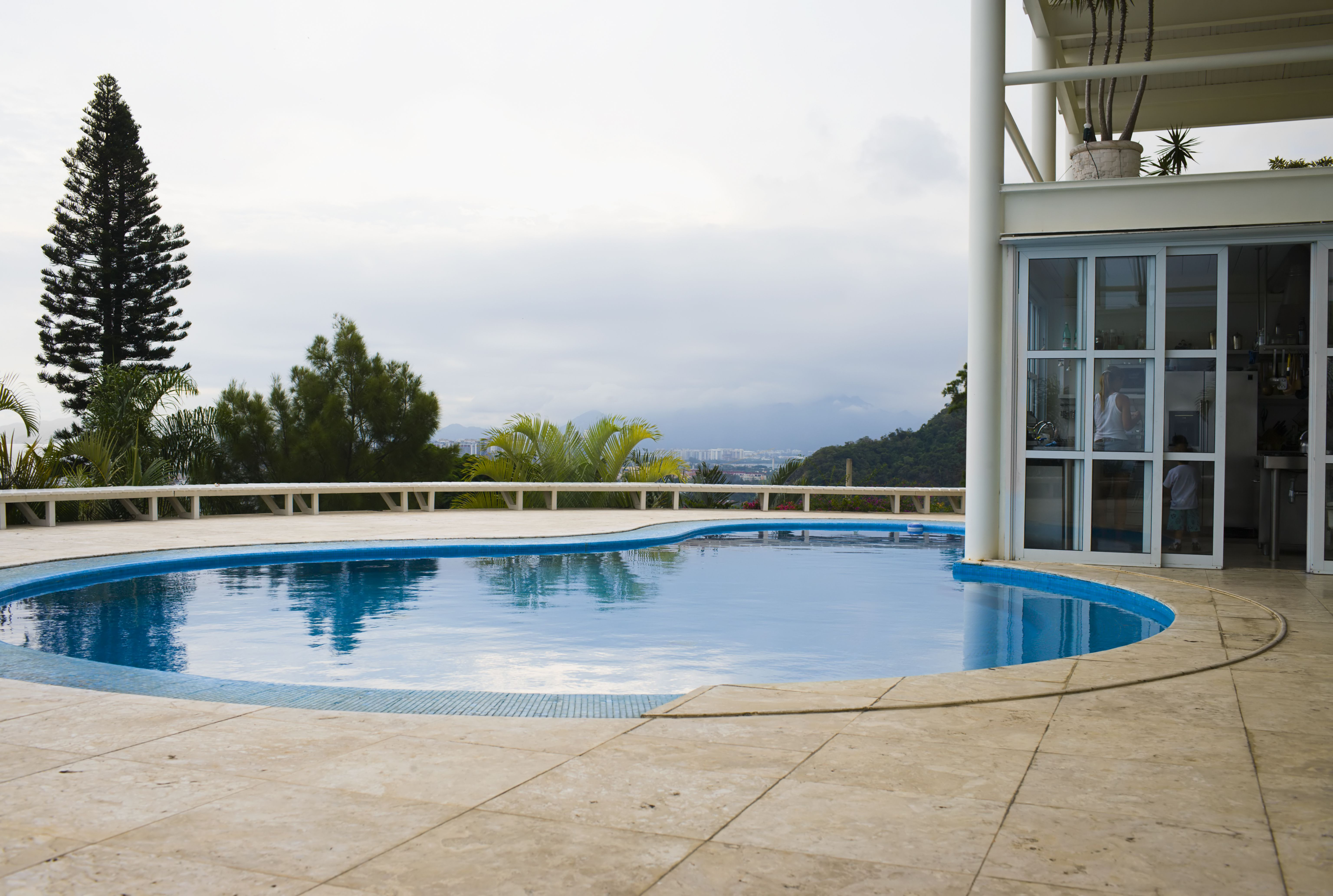 Modern house by Oscar Niemeyer, with glass, stone, and swimming pool