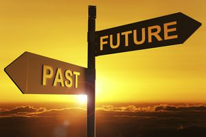 signs pointing towards the future and the past