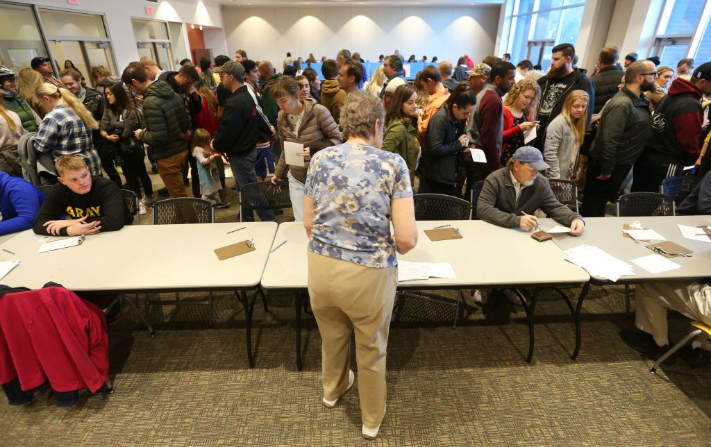 A crowd of people wait at a polling center to vote in the US midterm elections on November 6, 2018 in Provo, Utah.
