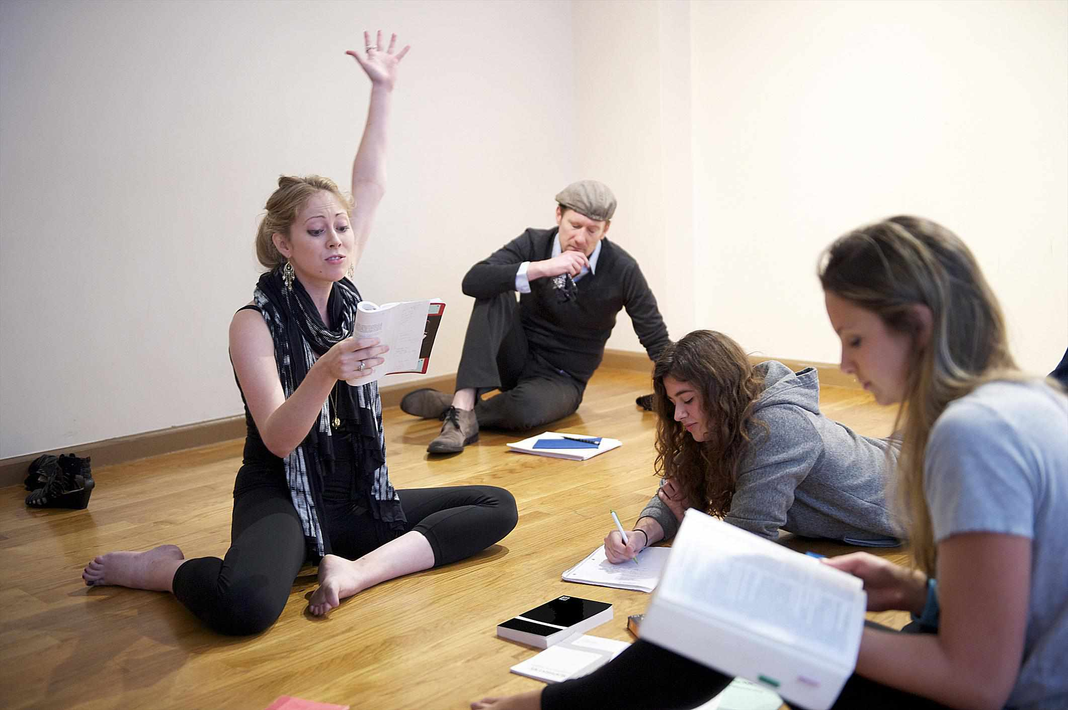 Young woman reading in acting class.