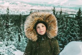 Girl with fur hood during winter