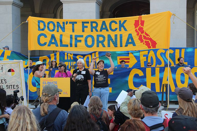 "People attend a rally as part of the anti-fracking movement in California. A banner above the stage reads, ""Don't Frack California."""