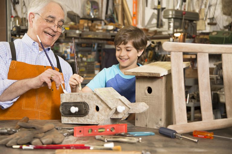 grandfather building birdhouses with grandson
