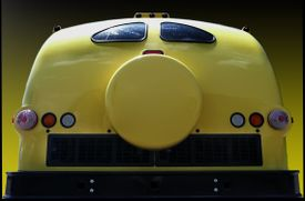 The back end of a yellow bus