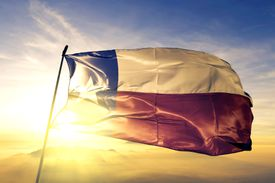 Texas state of United States flag waving in the sunset