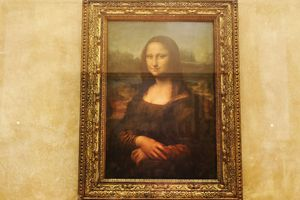The famous Leonardo Da Vinci painting The Mona Lisa seen on display in the Louvre in Paris, France.