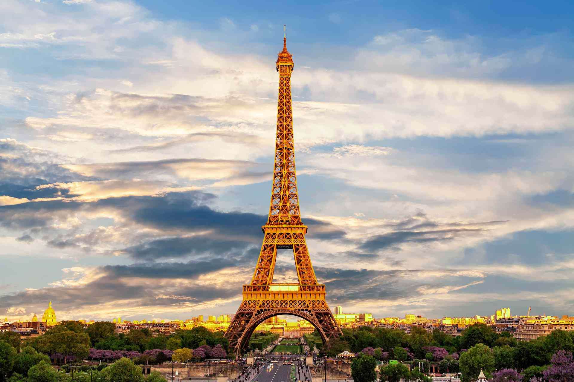 The Eiffel Tower in Paris against a blue sky.
