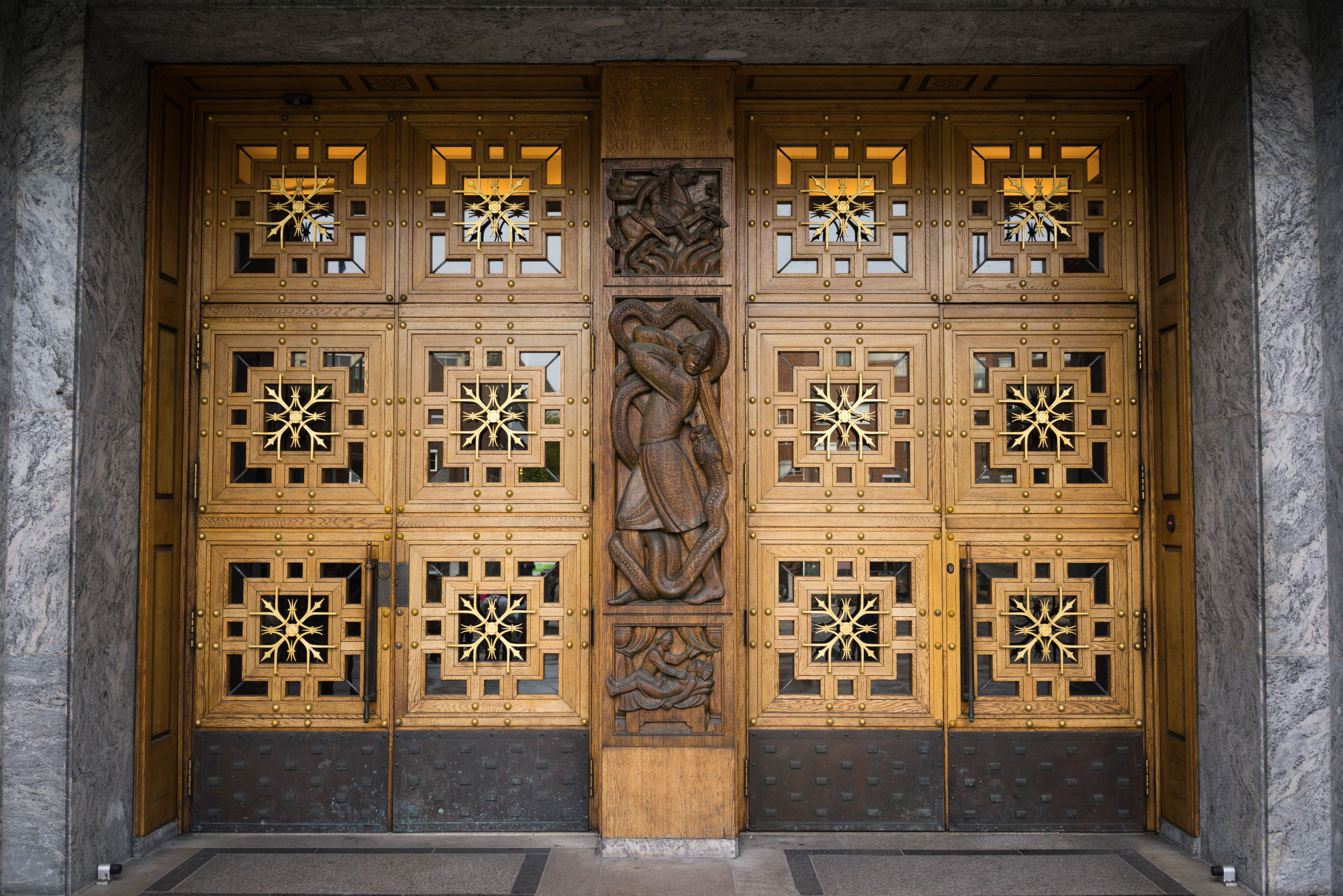 carved panels, six on each door, with carved sculpture between the doors