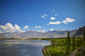 Indus River with mountains in the background