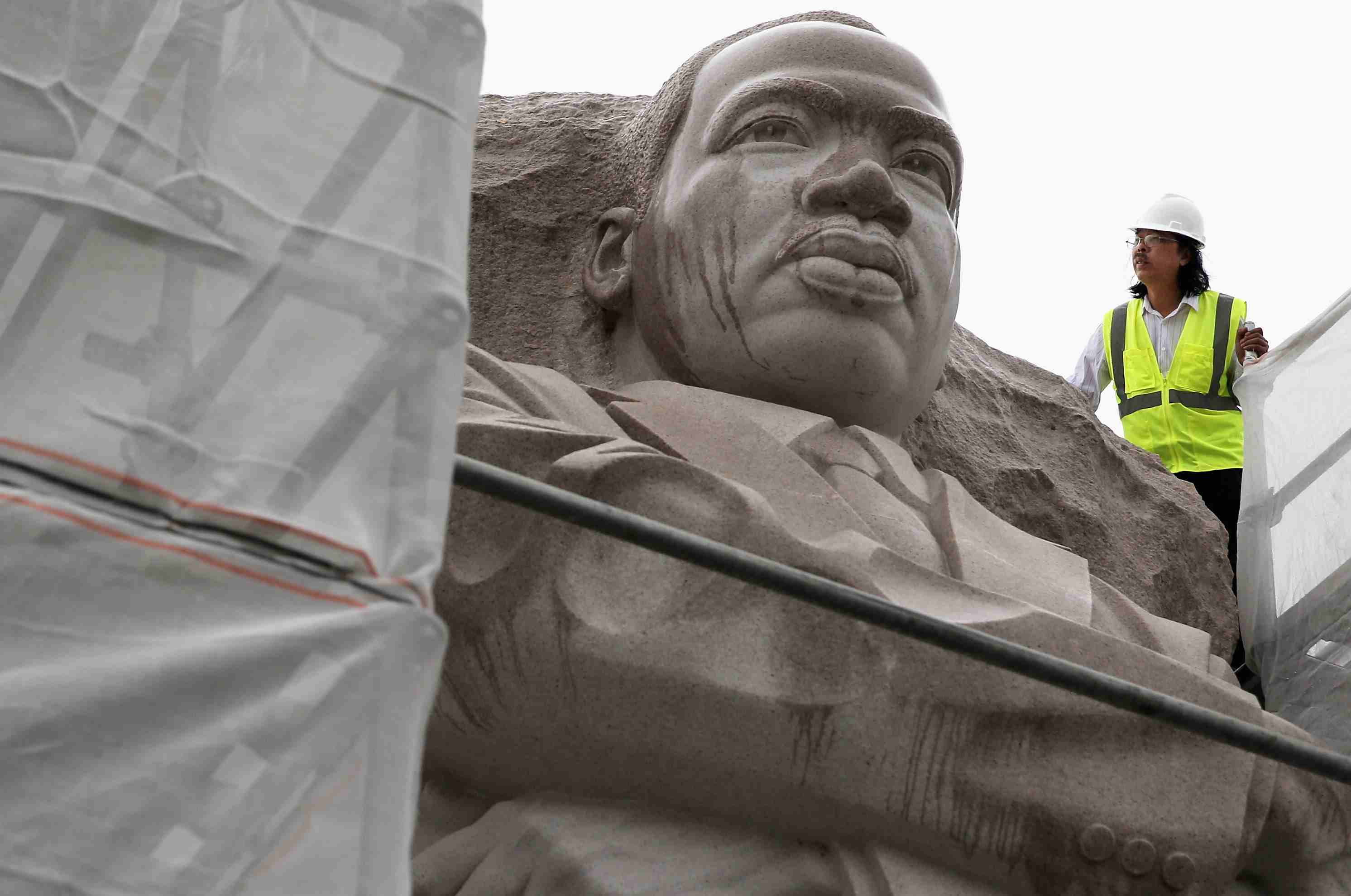 Sculptor Lei Yixin Examines Work Being Done To MLK Statue in 2013