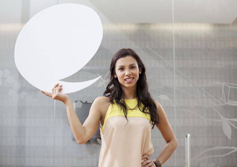 Woman holding a quote bubble next to her face