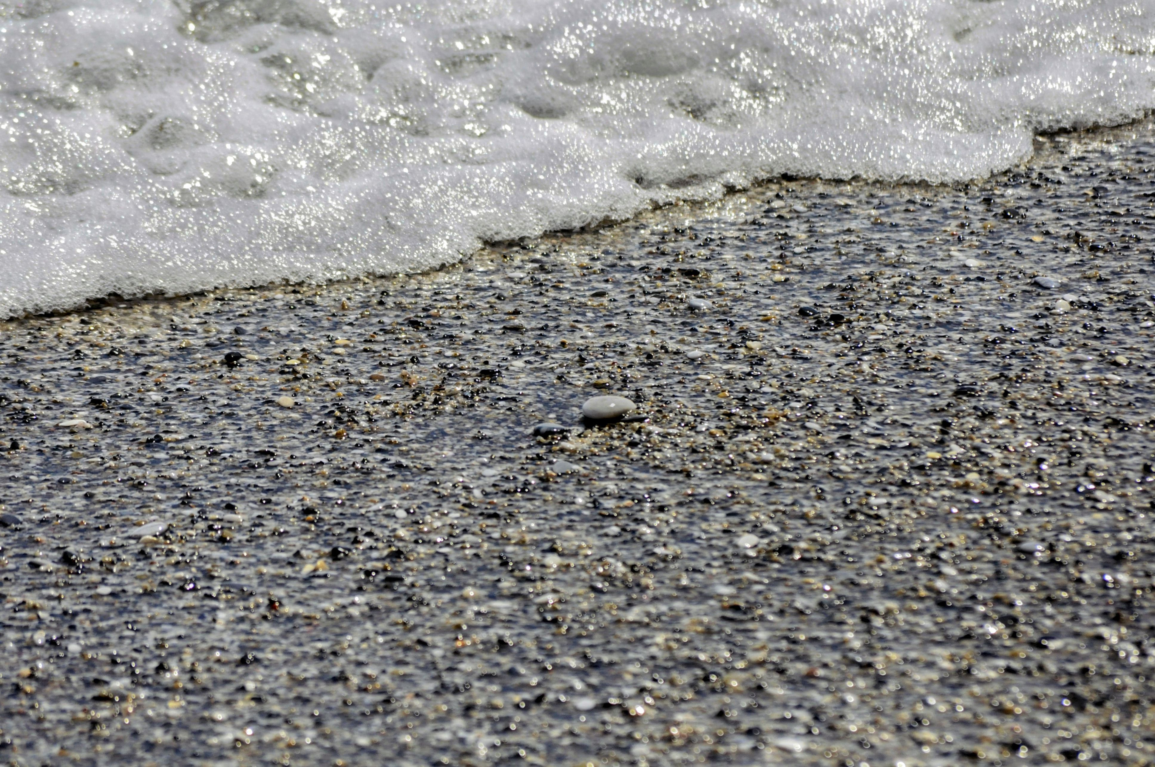 Over time, pebbles on a beach may form conglomerate rock.
