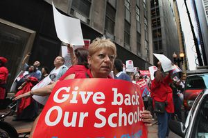 Woman holding sign at Teacher's Union Strike in Chicago