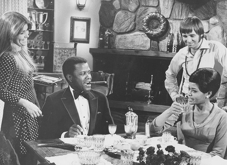 Actor, film director, author and diplomat Sidney Poitier, African-American jazz vocalist, songwriter and actress Abbey Lincoln, Beau Bridges, Lauri Peters, Nan Martin and Carroll OConnor during filming of the movie For Love Of Ivy, August 31, 1968.
