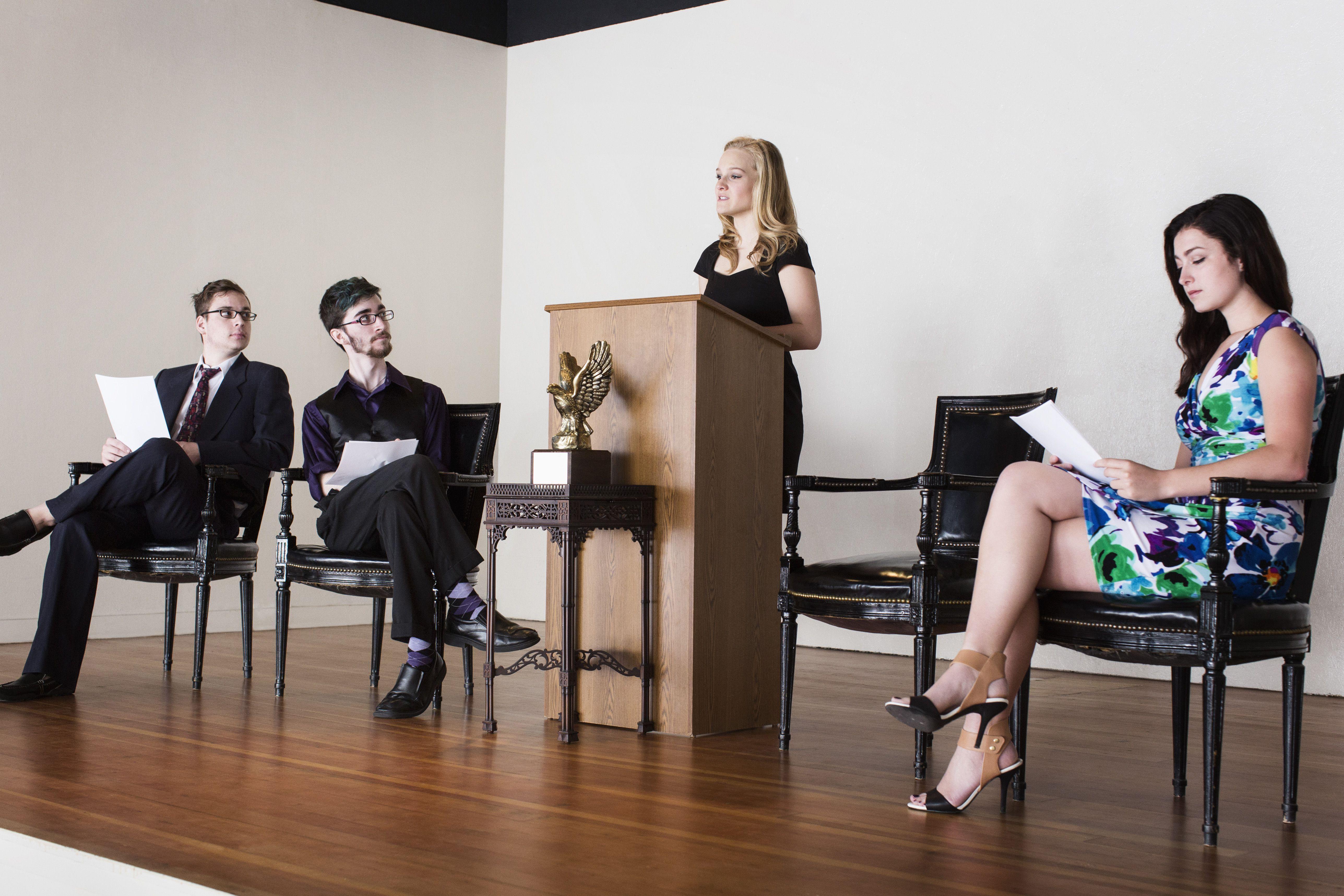 Debate team speaking on stage