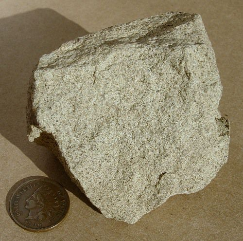 A piece of sandstone, a sedimentary rock usually made of mostly quartz