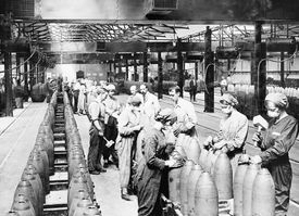 Women working in a munitions factory during WWI, black and white photograph.