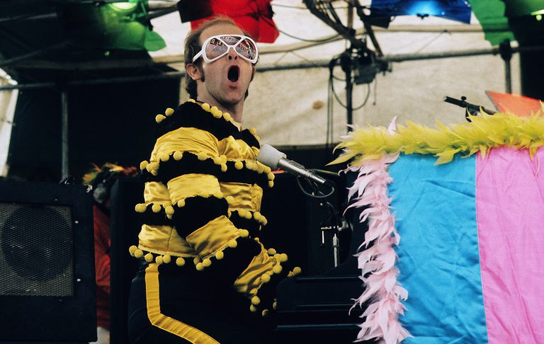 Elton John performs at an open-air concert in May 1974 in Watford, England