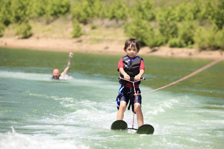 A young boy waterskiing