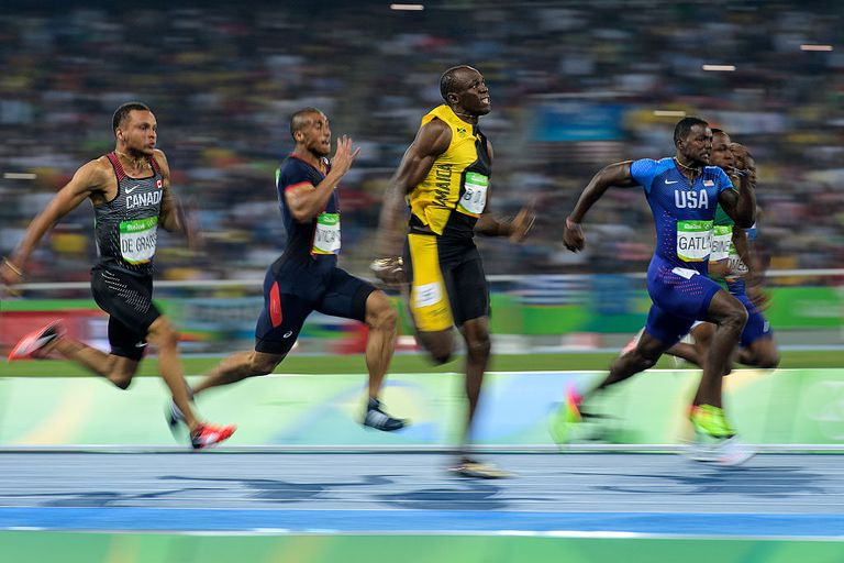 Usain Bolt of Jamaica leads the Men's 100 meter final to win
