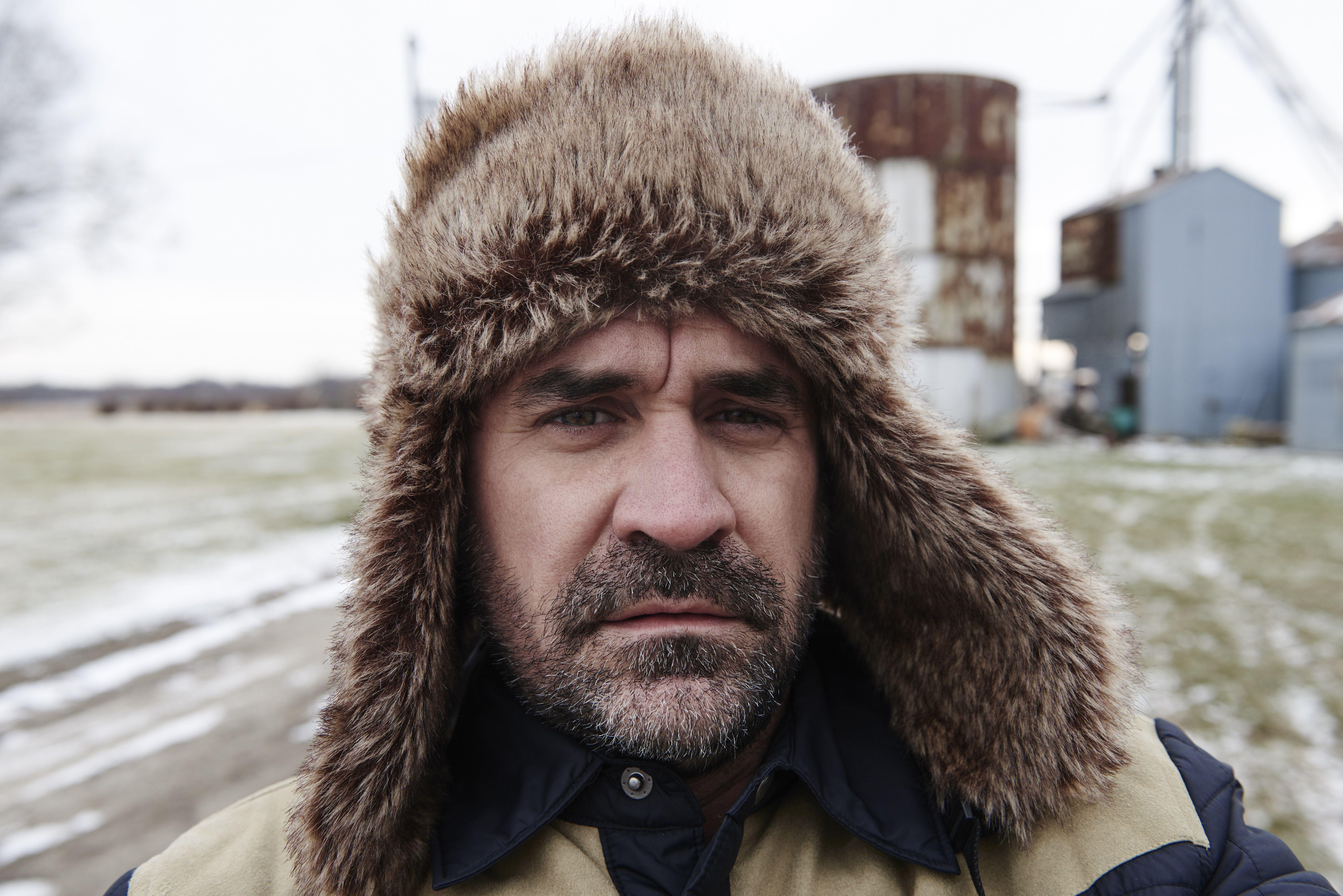 Portrait of mature man wearing trapper hat