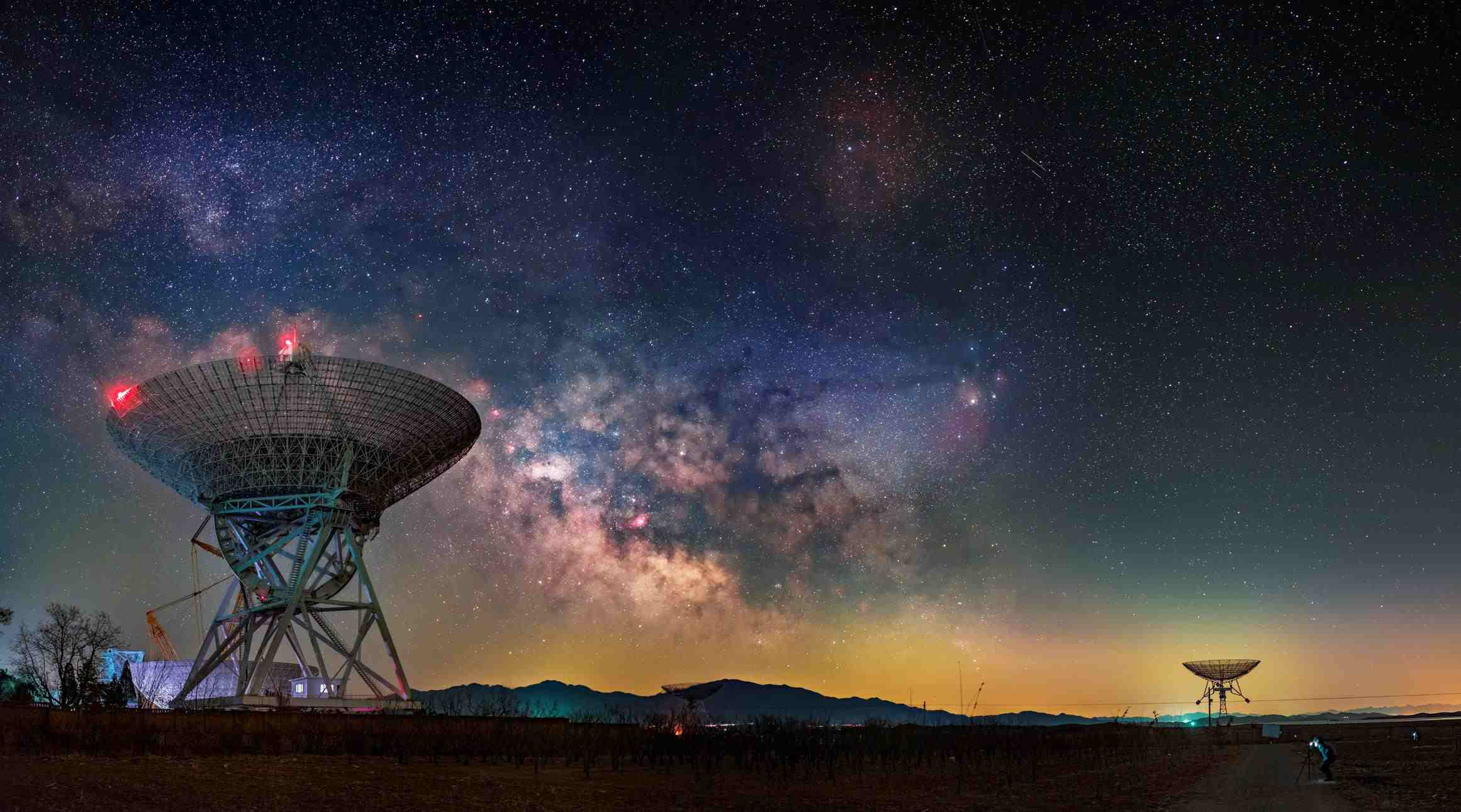 wide view of milky way with satellites