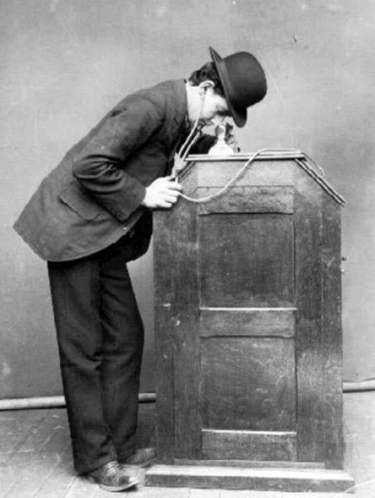 Publicity photograph of man using Edison Kinetophone, ca. 1895