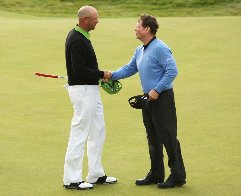 Stewart Cink of USA is congratulated by Tom Watson (R) of USA on the 18th green after claiming victory in a play off following the final round of the 138th Open Championship on the Ailsa Course, Turnberry Golf Club on July 19, 2009