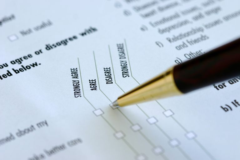 "A pen pinpoints ""agree"" on a research survey that uses a Likert scale"