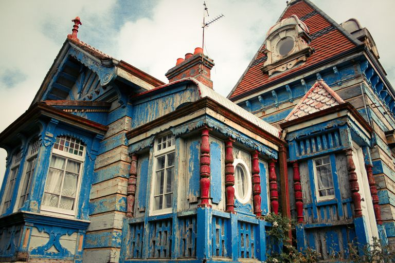 Wooden house with splintering paint.