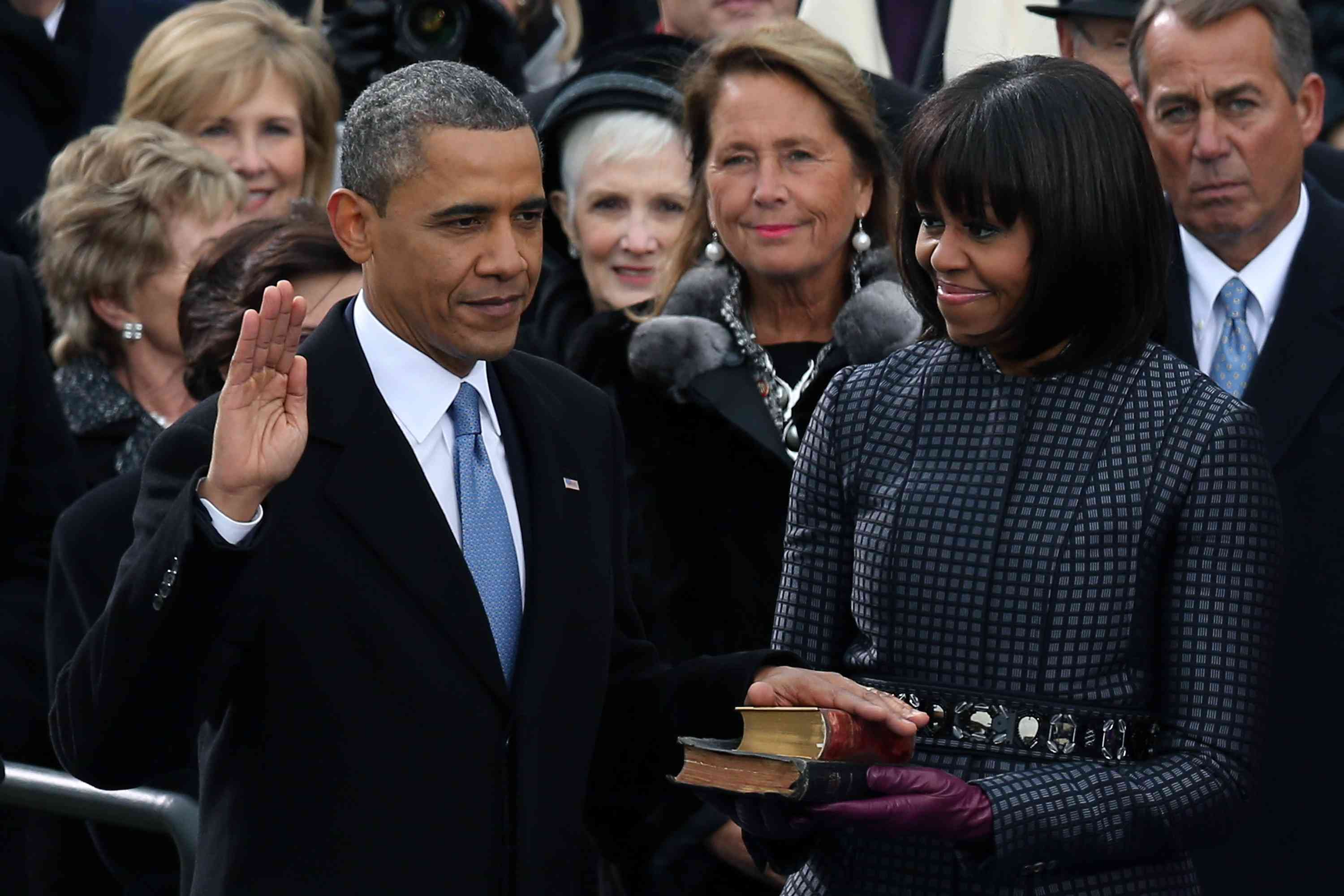 U.S. President Barack Obama is sworn in as First lady Michelle Obama looks on.