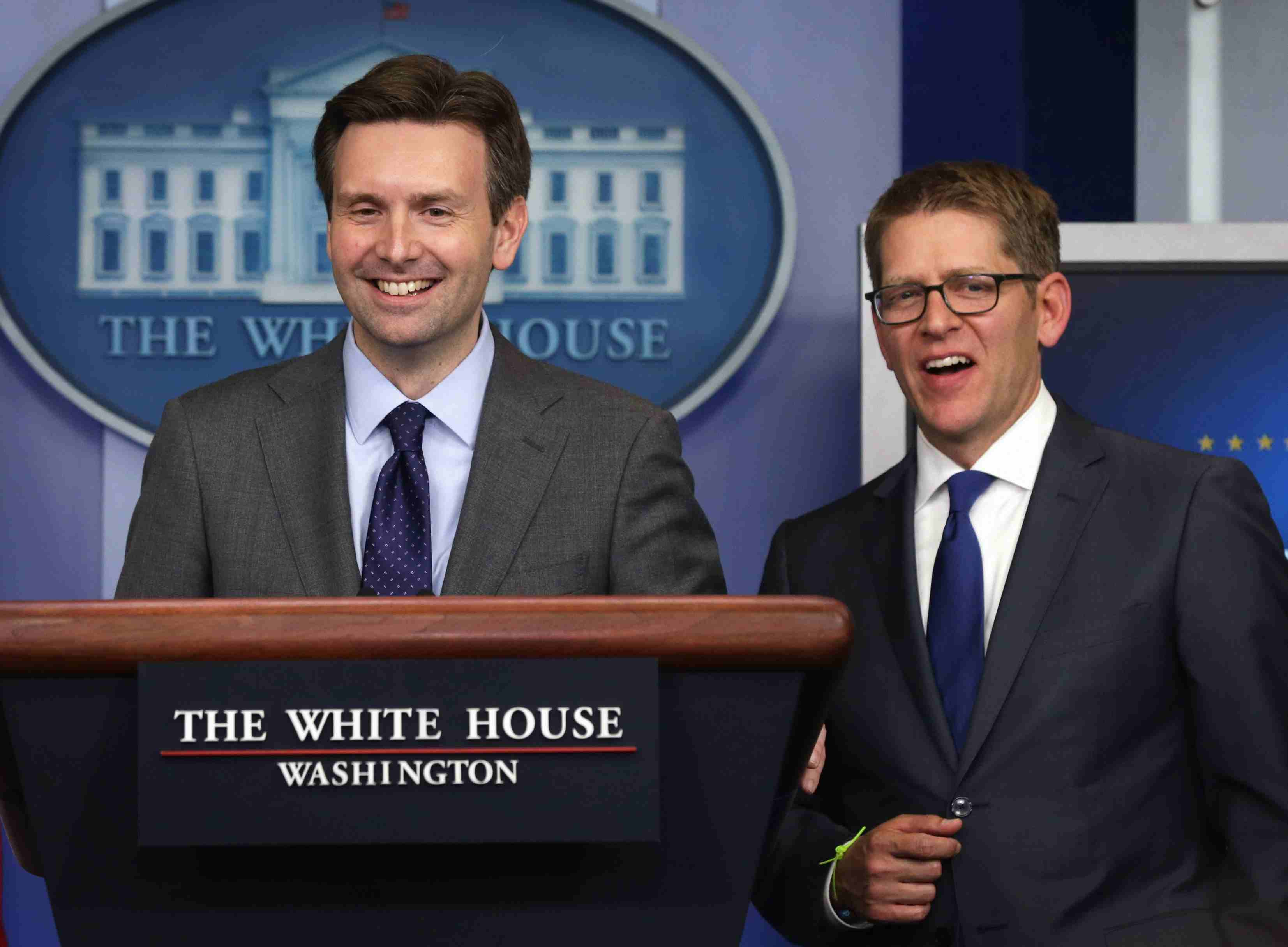 Josh Earnest left, with Jay Carney right