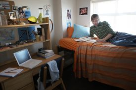 Student reading in his dorm room