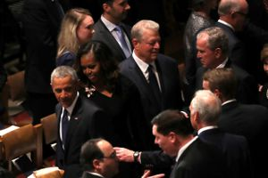 Former President George W. Bush and Former Vice President Al Gore conversing at the funeral for W's father, the late President Bush the elder
