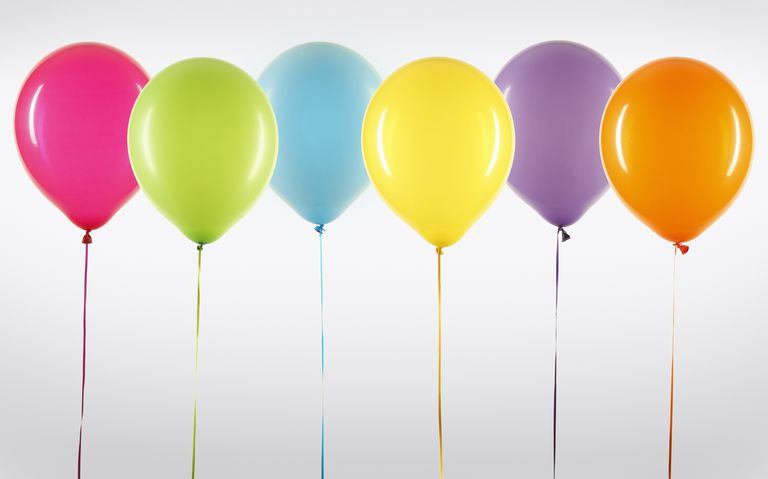 A row of colorful helium balloons
