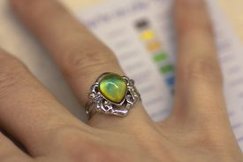 A mood ring on a finger