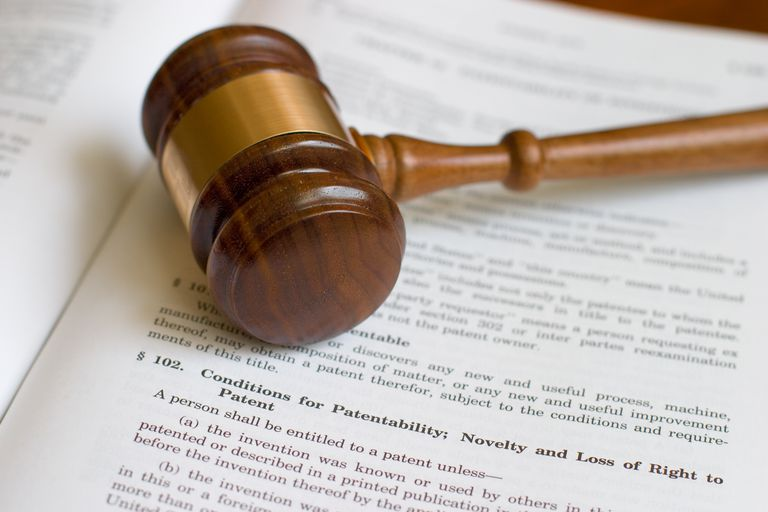 gavel on top of page of patent law