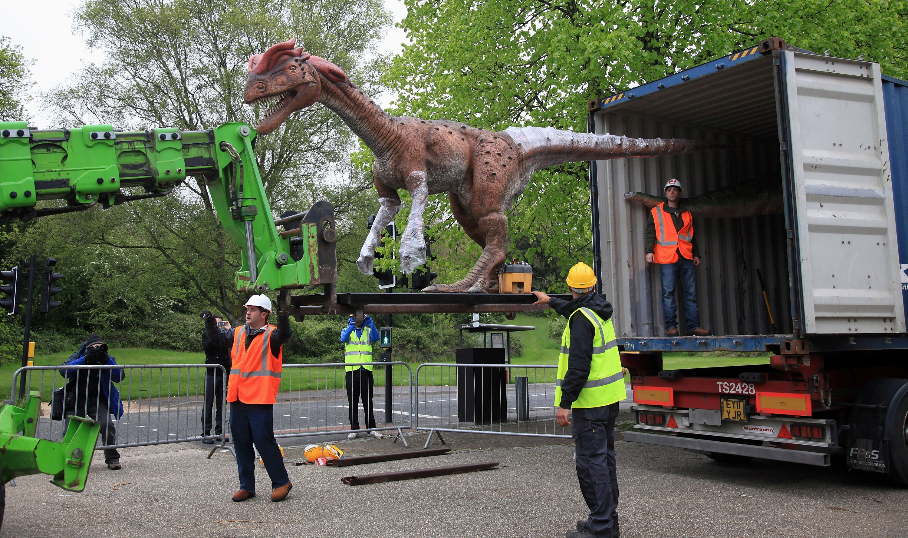 animatronic dinosaurs being unloaded from truck