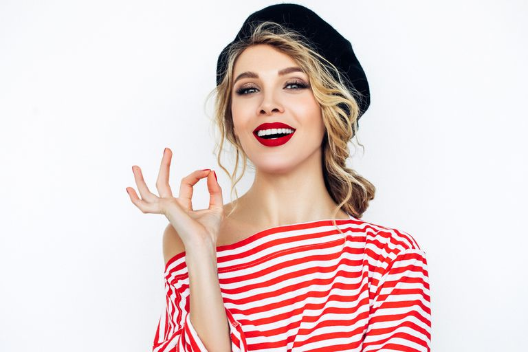 "woman in beret giving ""okay"" hand gesture"