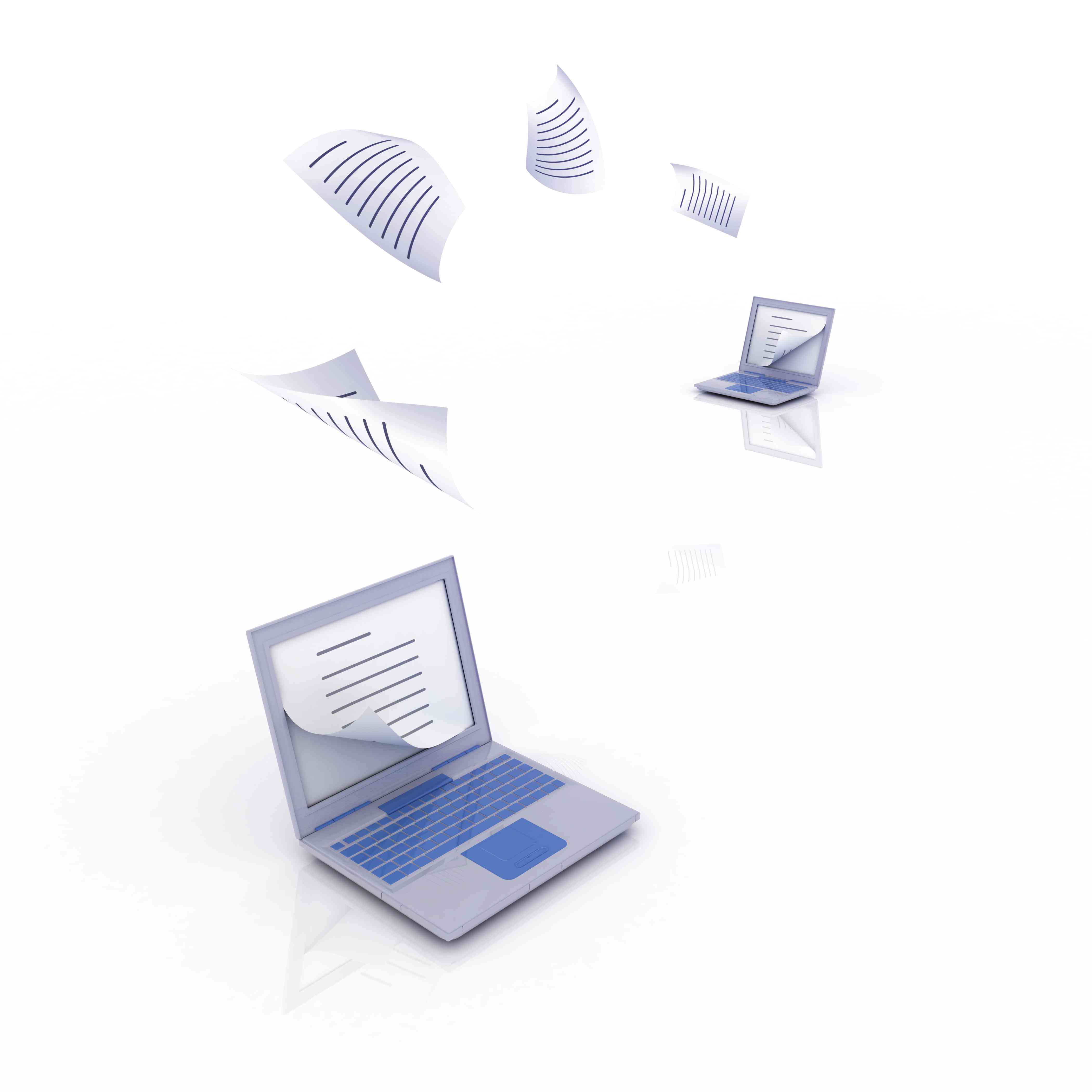 Paper floating from one laptop to another, depicting transferring WordPress blog files to Blogger