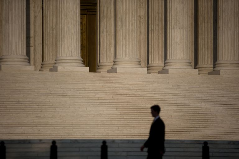 A man walks past the Supreme Court