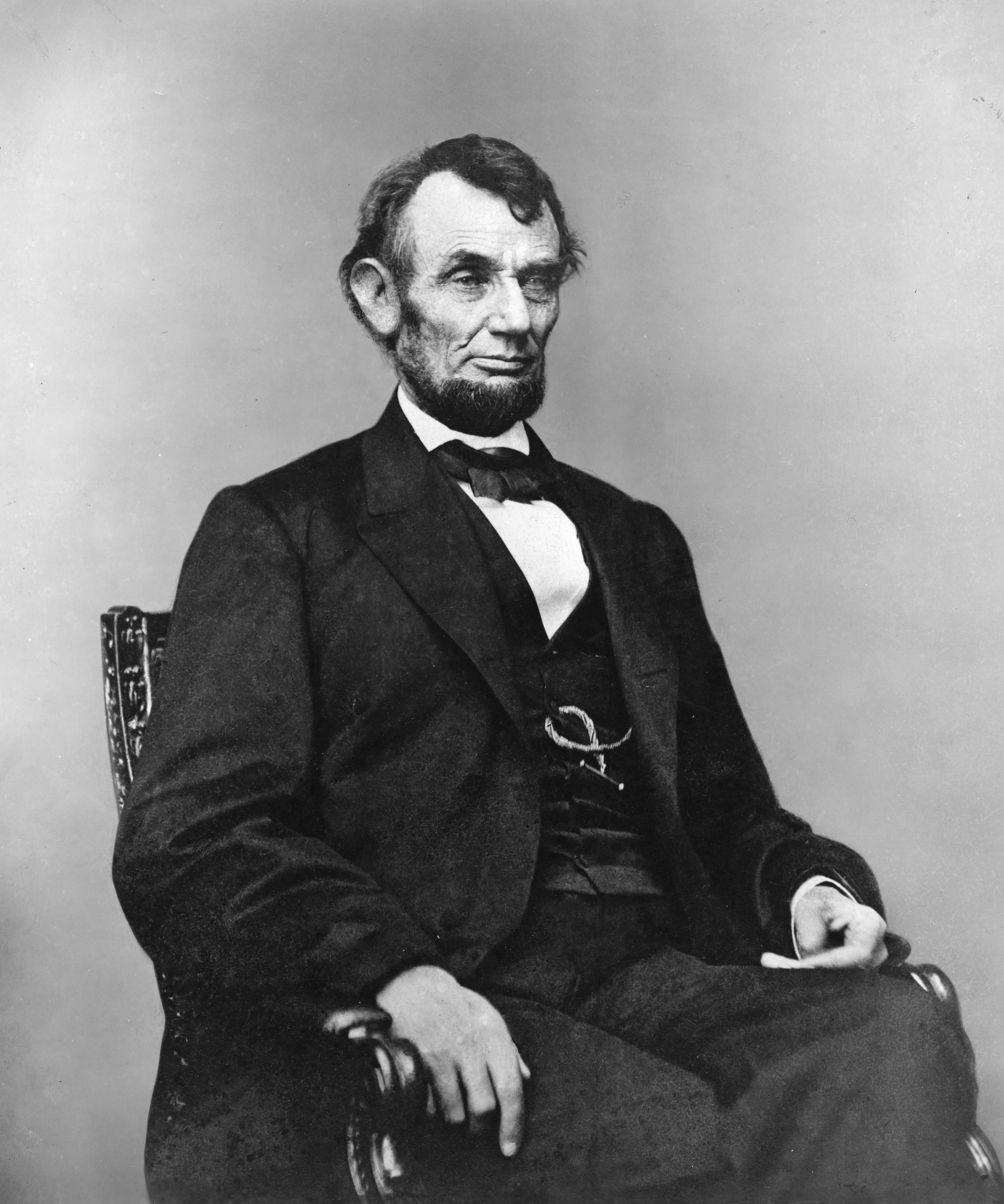 Abraham Lincoln, Three-Quarter Length Portrait, Seated, Facing Right; Hair Parted On Lincoln's Right Side. 1864 Feb. 9
