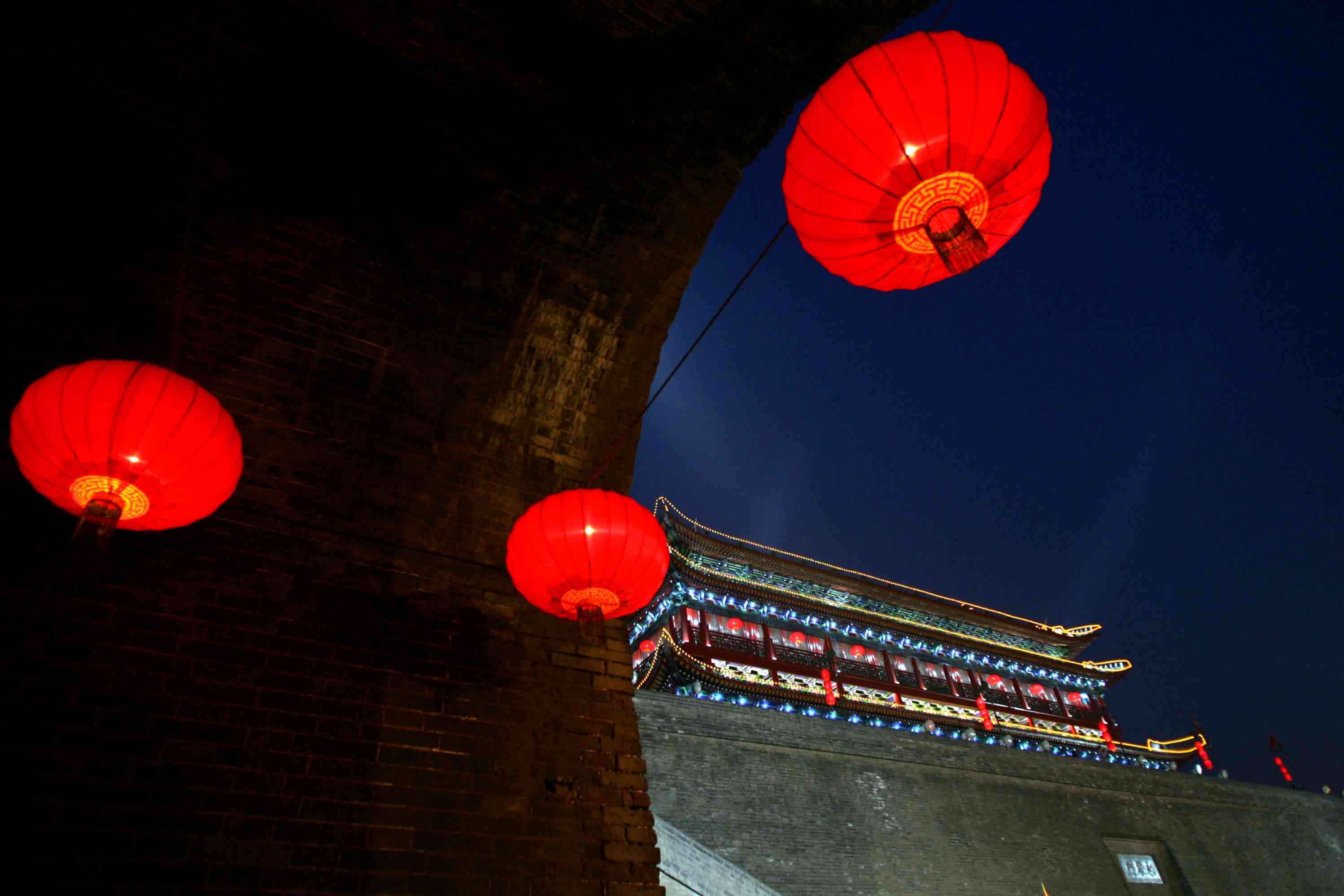 In preparation for the Lantern Festival after the lunar New Year, the Ming Dynasty City Wall Relic is illuminated by lanterns Xian, Shaanxi