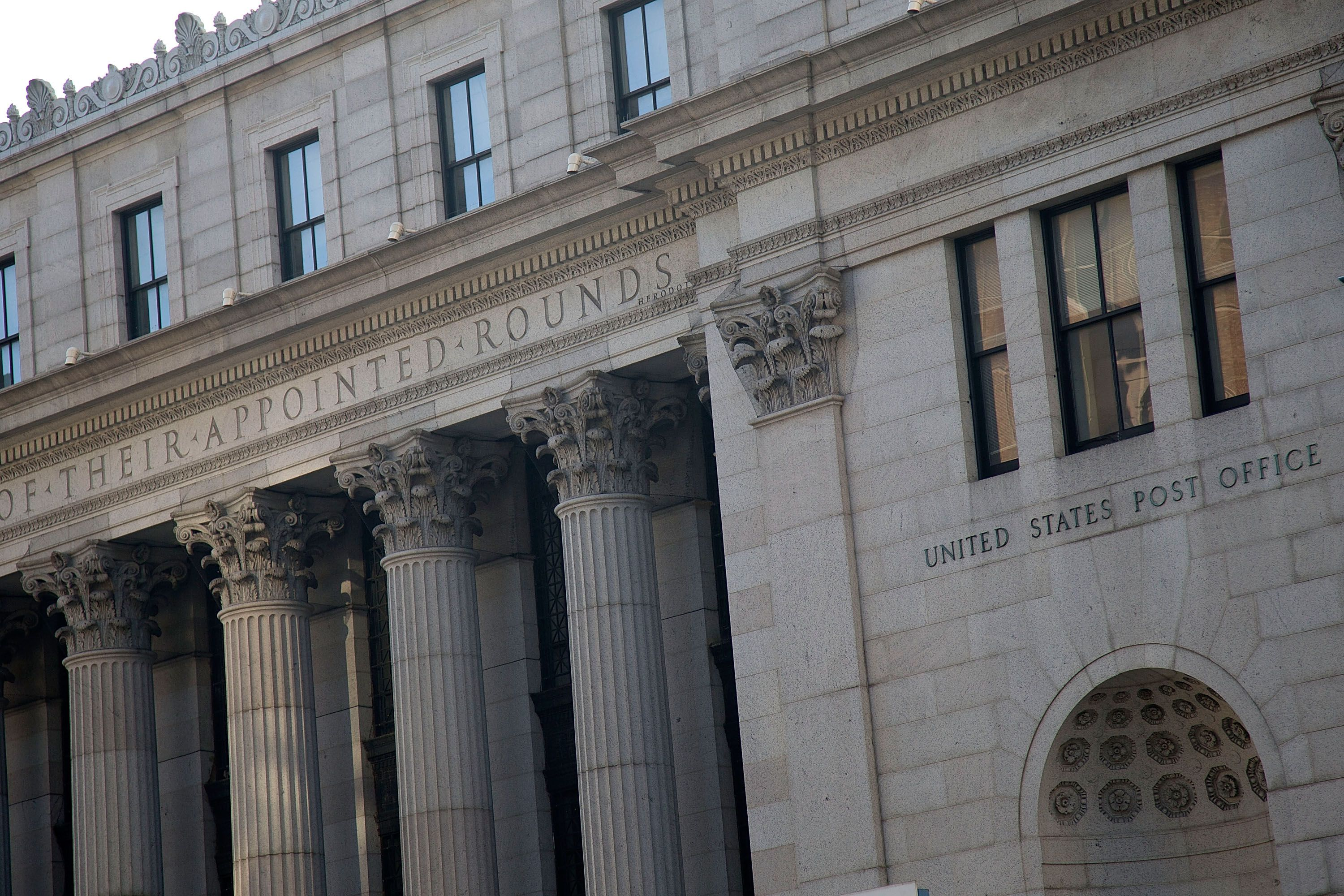 detail facade with inscription of their appointed rounds carved above columns, united states post office to the right of pilaster