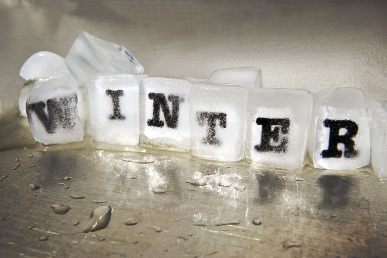 winter spelled out inside of ice blocks
