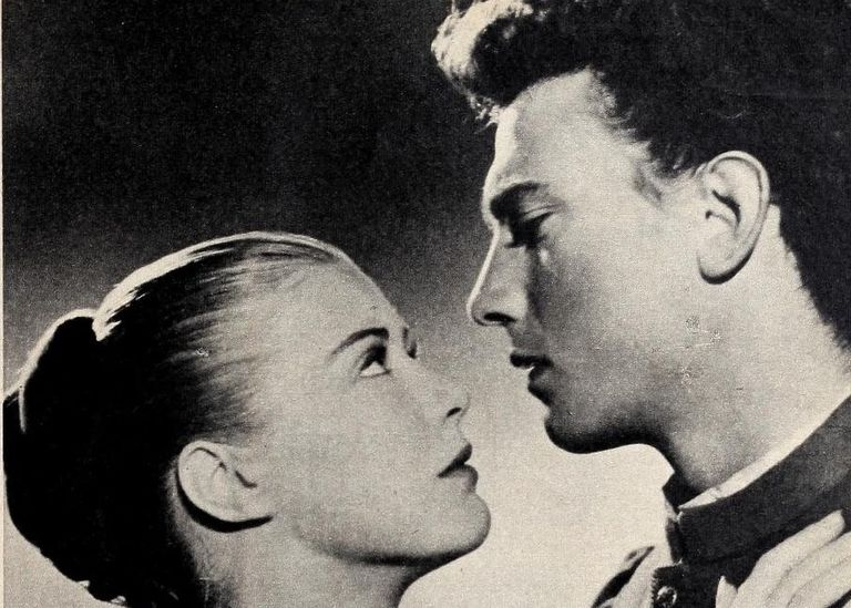 Black and white photo of two actors portraying Romeo and Juliet.