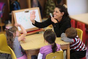 Teacher congratulates math student