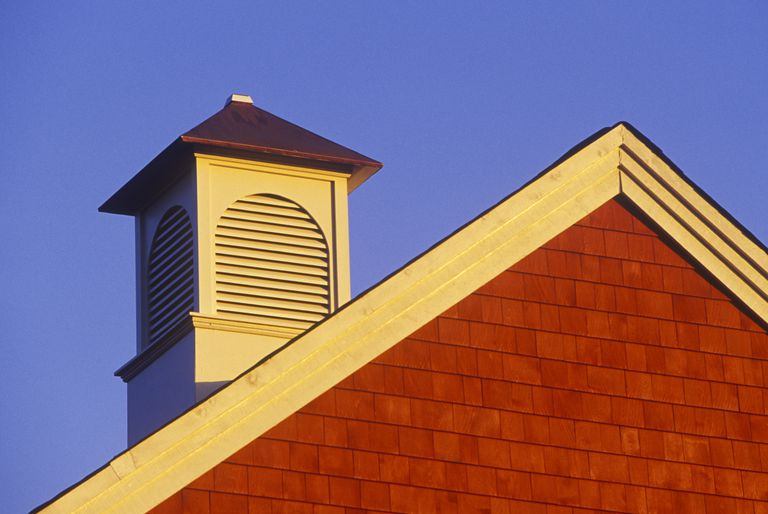 Yellow gable cupola vents the red-shingled gable